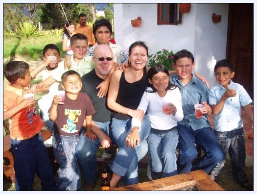 "Susan and Doug with some of their ""kids"" in Colombia."