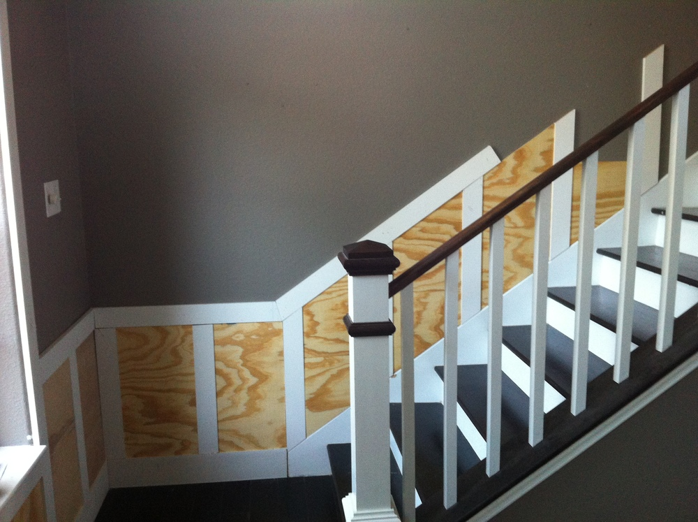 Installing the plywood panels along the stairs