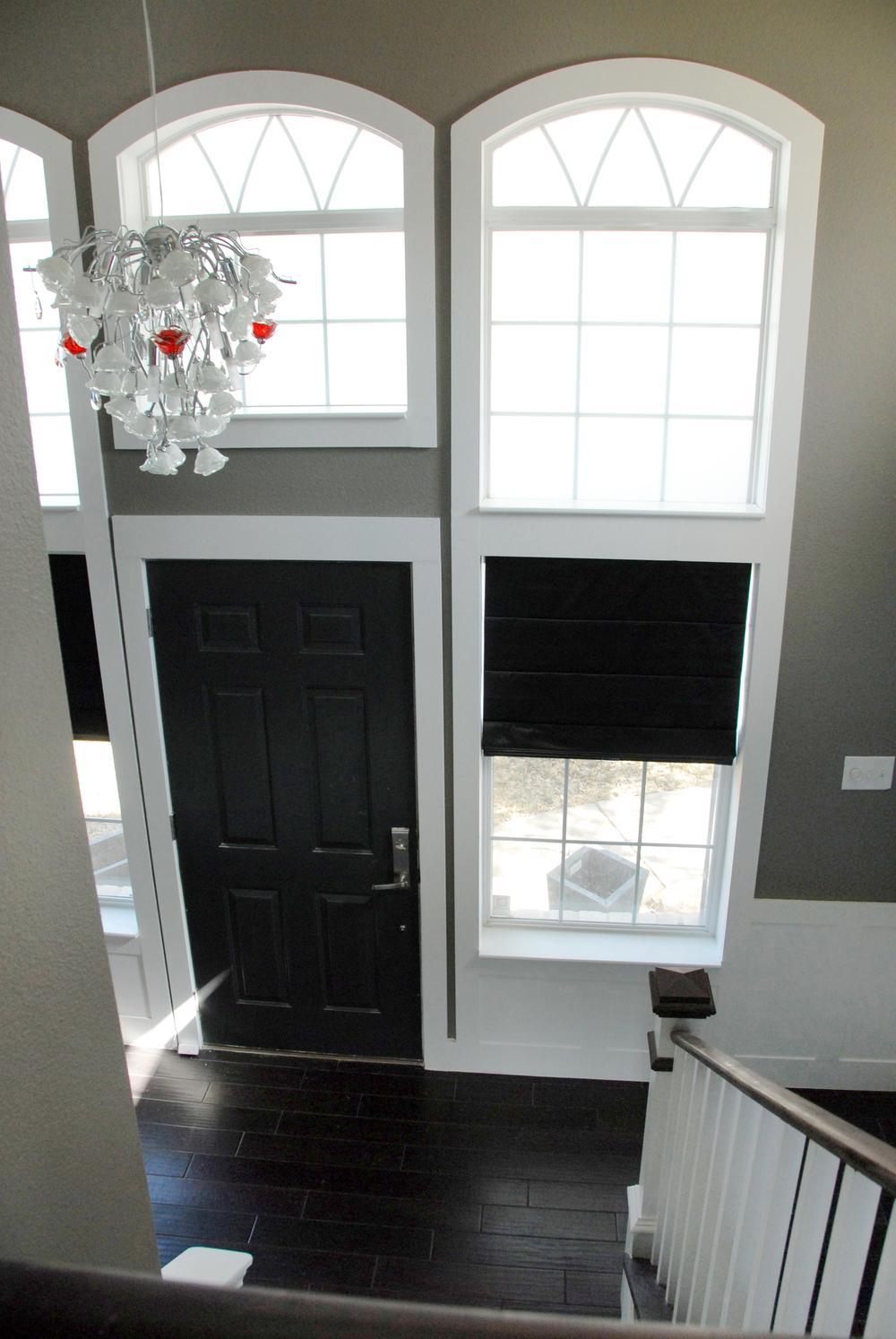 Arch windows over door after