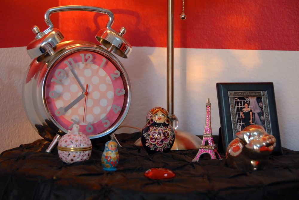 Her bedside table full of trinkets from my travels.