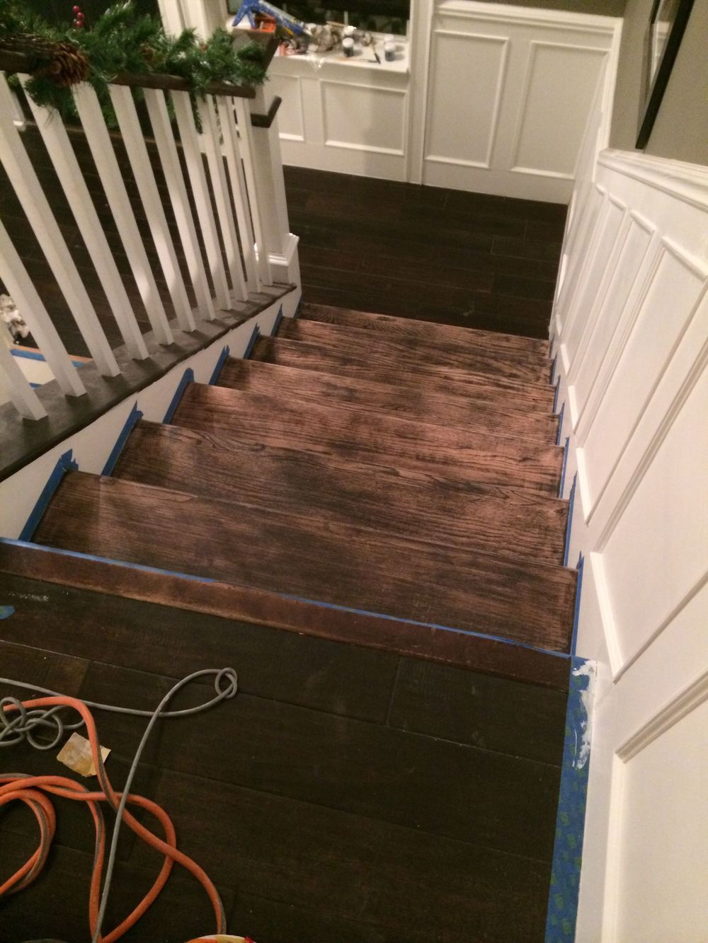 Step 11: Refinish the stairs (again) after the bathroom remodel destroyed them.