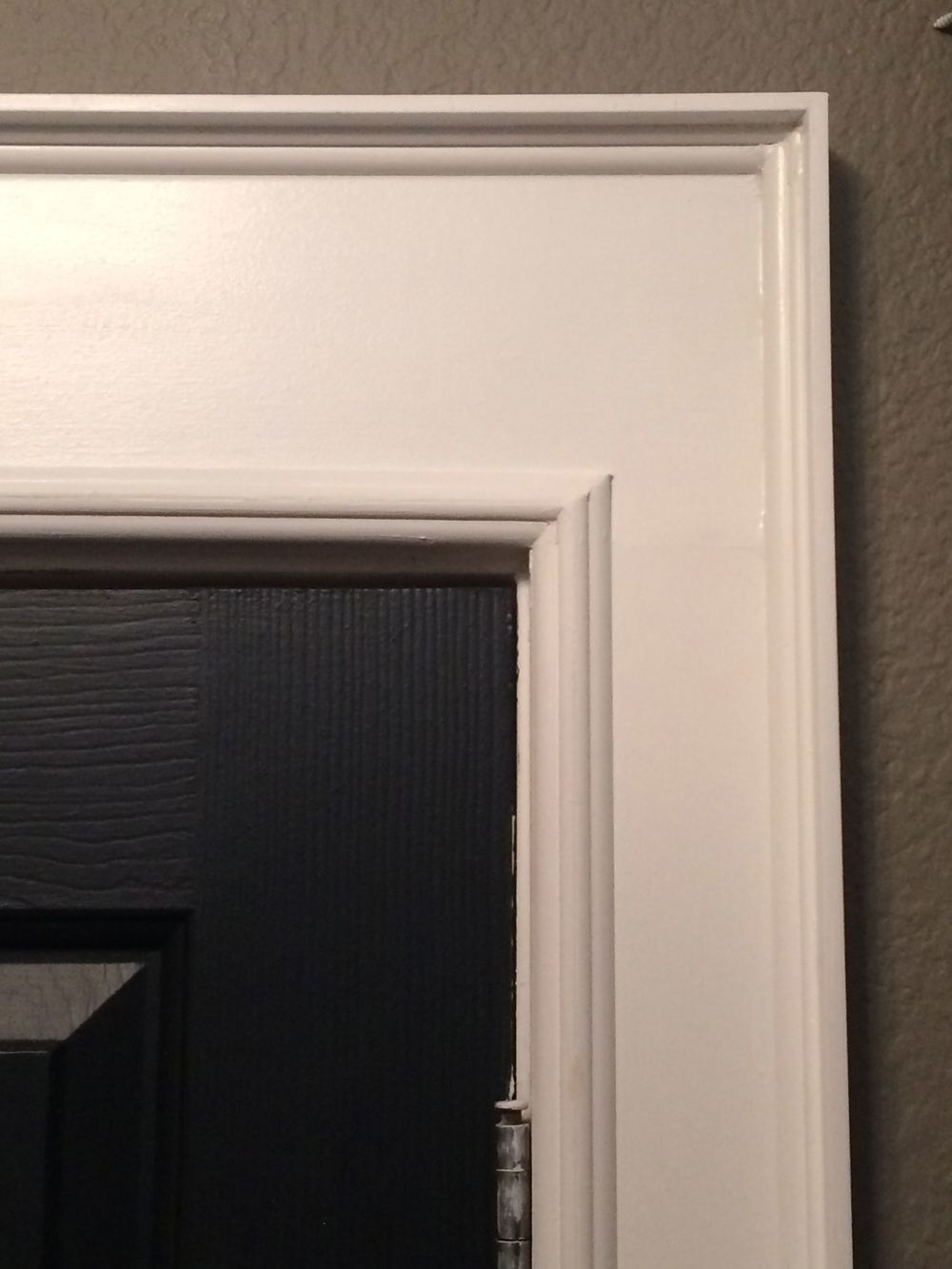 Step 9: Spruce up the trim around the doors.