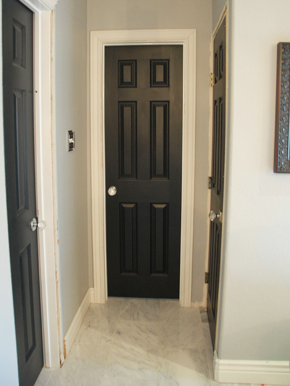 The hallway of black doors (with the same crystal knobs as the closet)