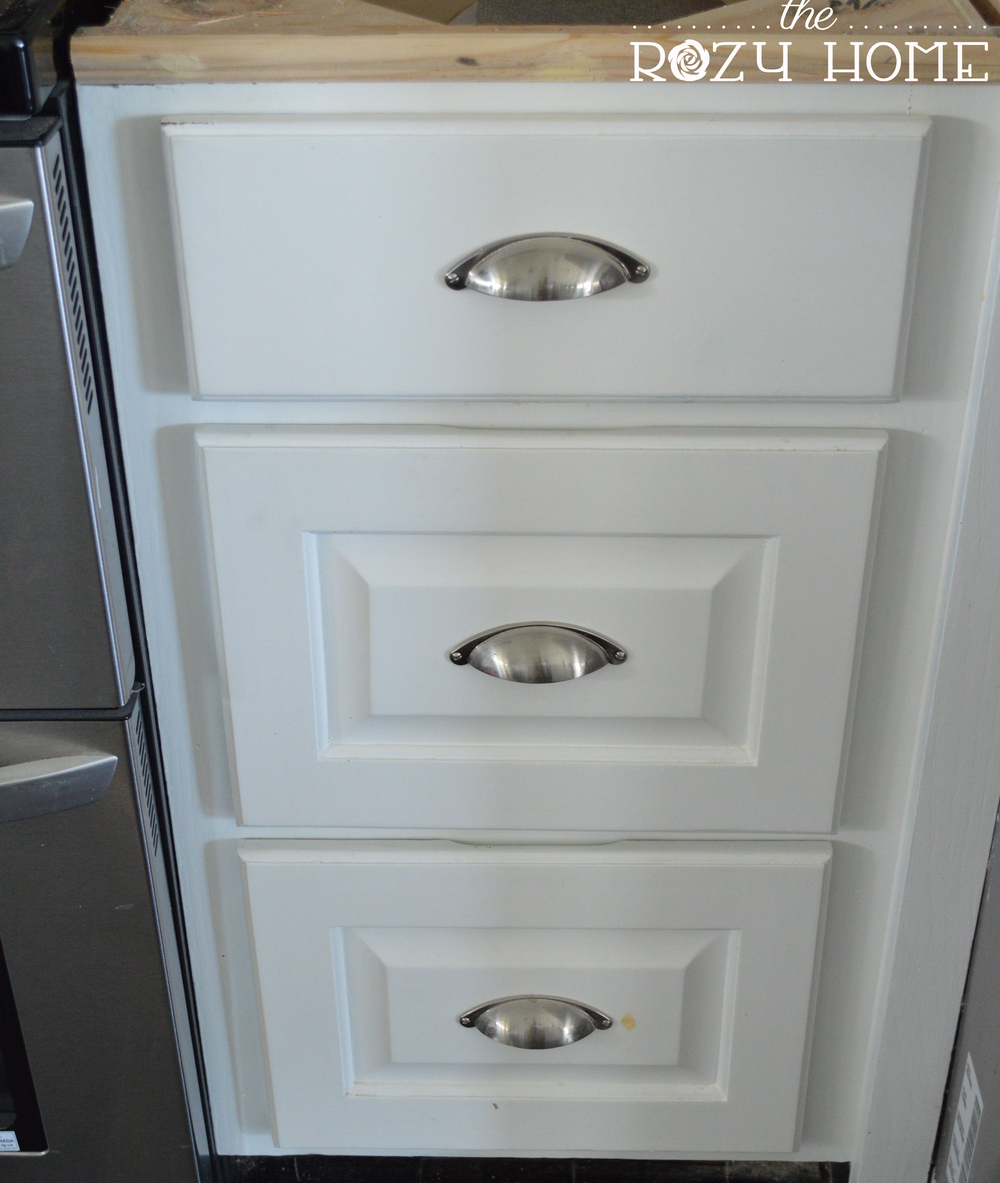 Easy and inexpensive cabinet updates adding trim to for Add drawers to kitchen cabinets