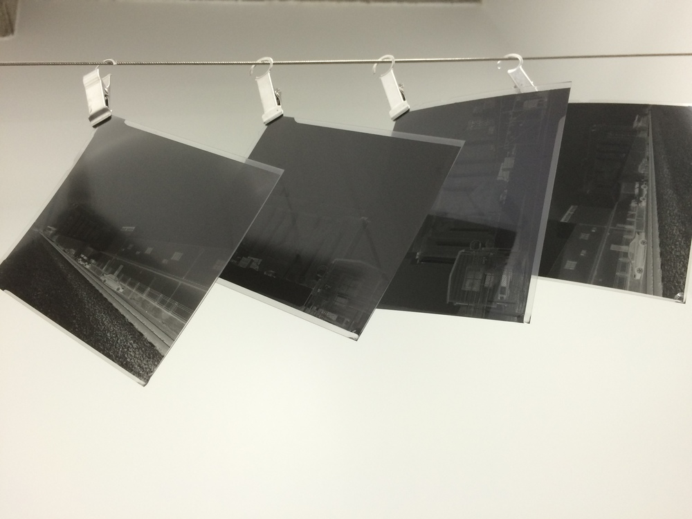 Four negatives of SILOS images fresh from developing and hanging to dry.