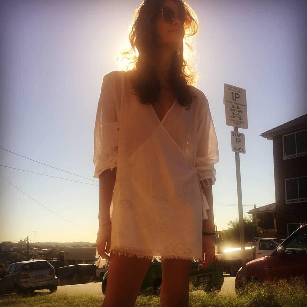@margotsmile looking cool in our Dreamer Wrap dress   Follow us on instagram - instagram.com/desertsunbrand/