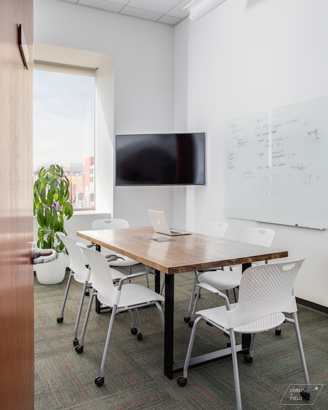 Conference rooms are outfitted with custom tables and comfortable chairs.