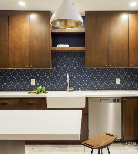 AFTER: Recessed lighting keeps the small space clutter free, while the pendant adds some interest.