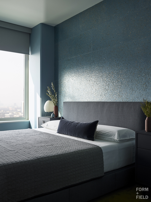 AFTER: Blues and grays create a calm and peaceful retreat in the master bedroom.