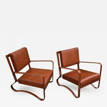 Hand-stitched leather lounge chairs, 1950s-1960s  (   source   )