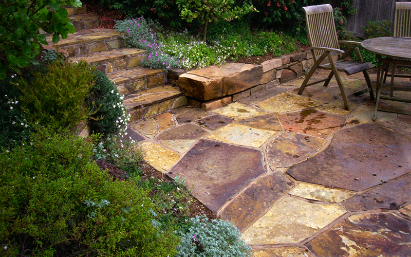STONE & MASONRY - Our artisans have years of experience building stone patios, walls, and stairs.