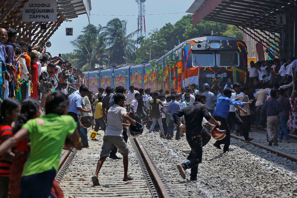 Sri Lankans rushing to visit former war zones when ban was lifted by the government (2014). Photo: SBS News