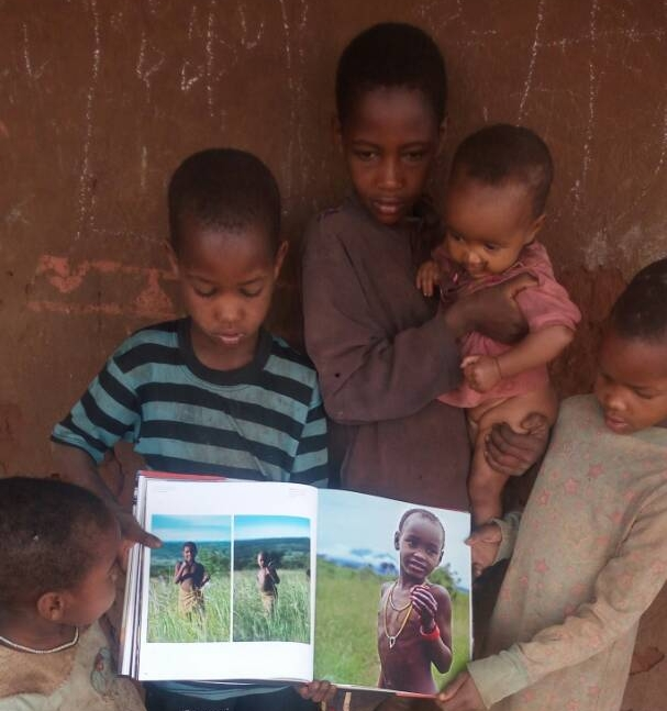 Barabaig children enjoying Lane's book, Barabaig: Life, Love and Death on Tanzania's Hanang Plains