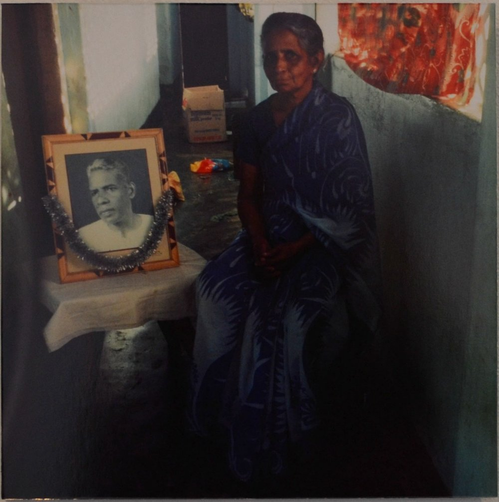 Elderly Batticaloa resident with portrait of her disappeared husband. Photo: Stephen Champion