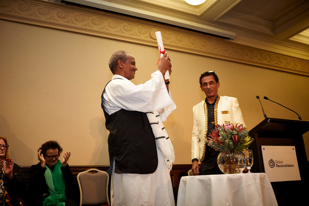 Dr Zeremariam Fre receives Desmond Tutu Reconciliation Fellowship award at Melbourne Town Hall, 4 October 2018.