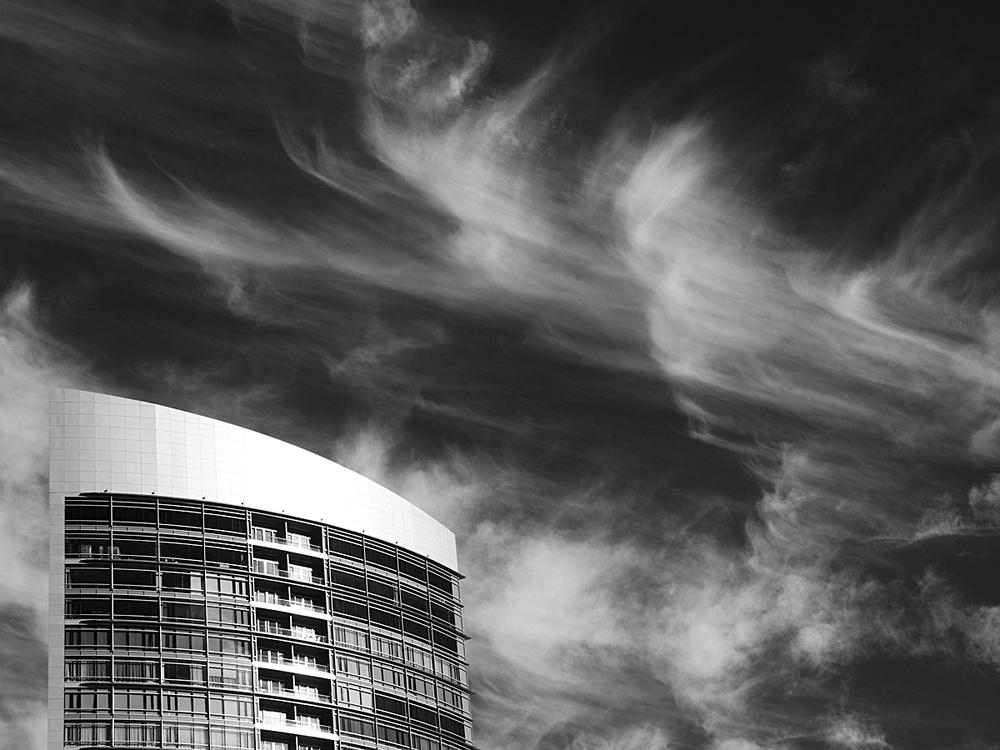 skyscraper and clouds hotel exterior.jpg