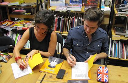 Valérie Amiraux and Francis Desharnais signing their book,  Salomé et les hommes en noir