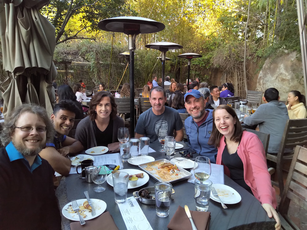 Rory with CSU San Marcos colleagues talking science at Stone Brewing