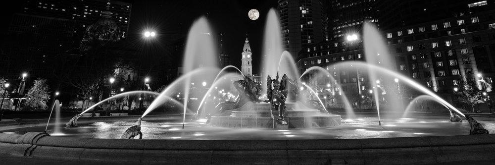 The full moon rises over city hall in Philadelphia