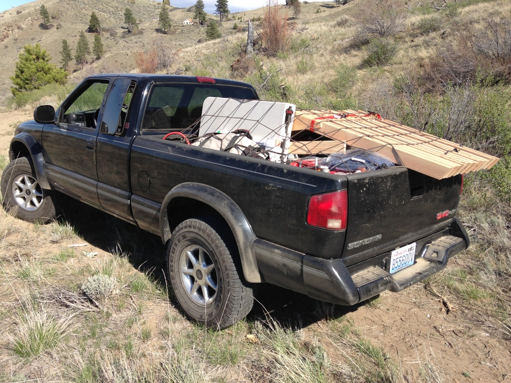 Cody loaded up with gear and trusses.