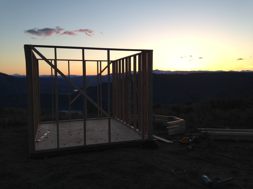 The first day of building complete. A foundation, a floor, and a stick frame.