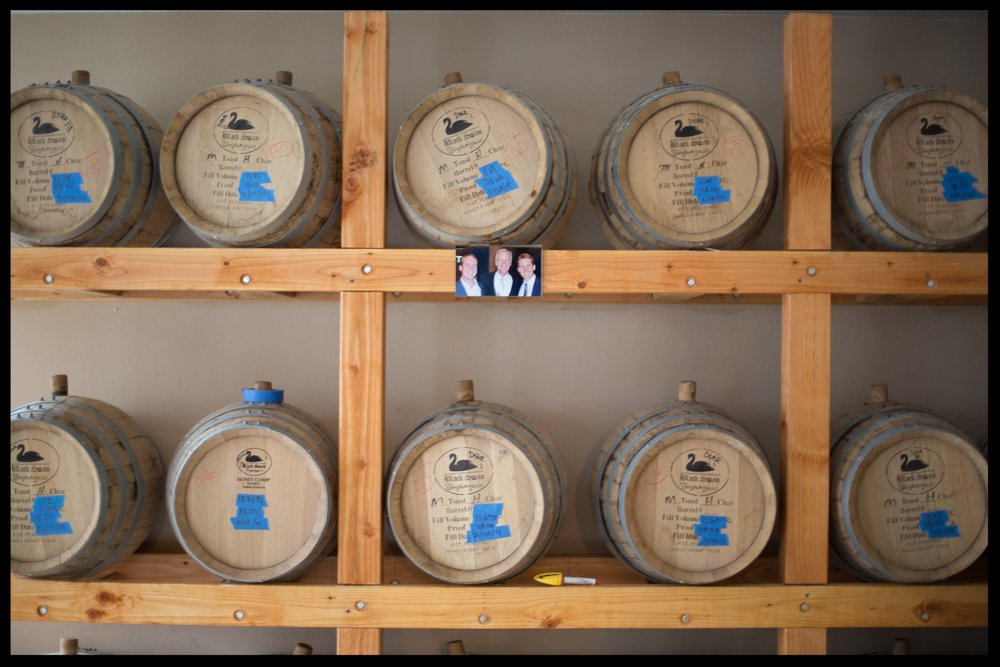 A family photo next to the barrels.