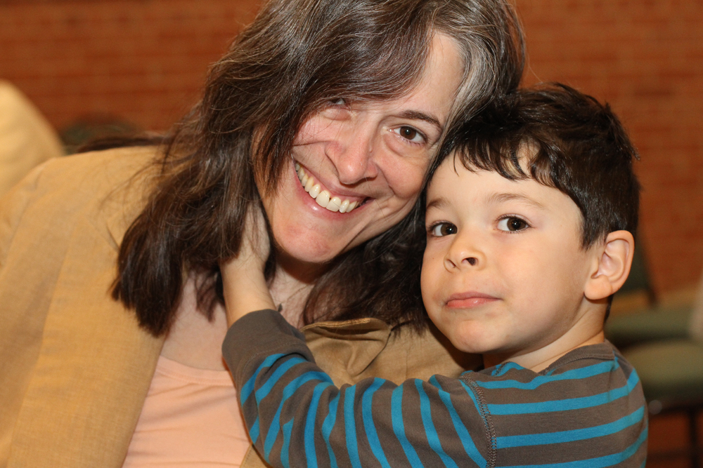 Mother with her son at a Tu B'Shevat seder