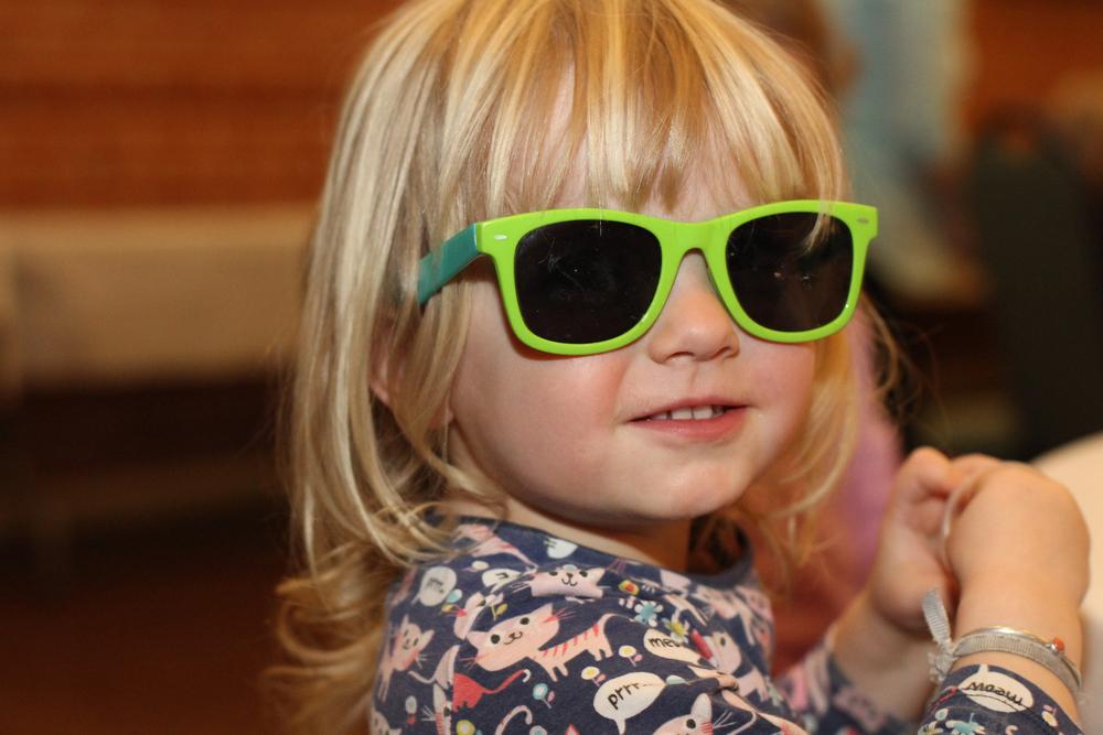 Toddler girl wearing her sunglasses.