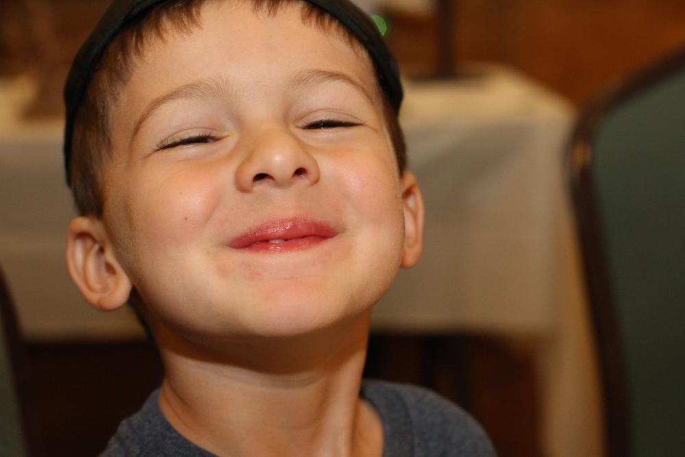 Child smiling at his Tucson preschool.