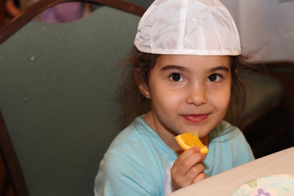 Preschool girl eating lunch.