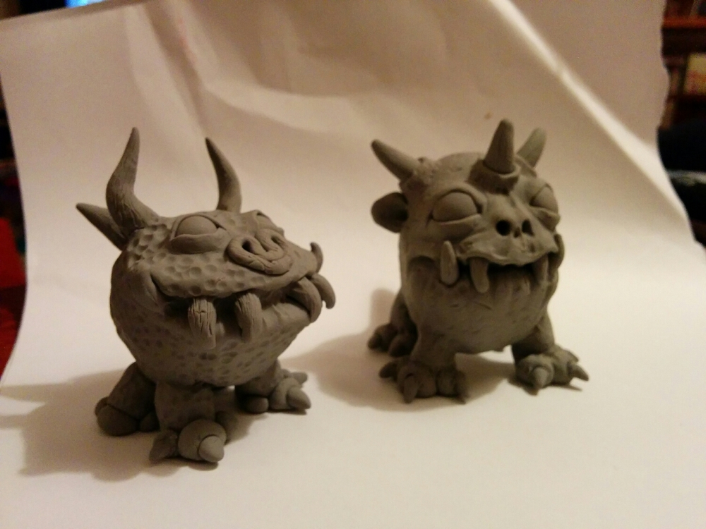 my sisters first super sculpey monster on the left, my monster on the right.