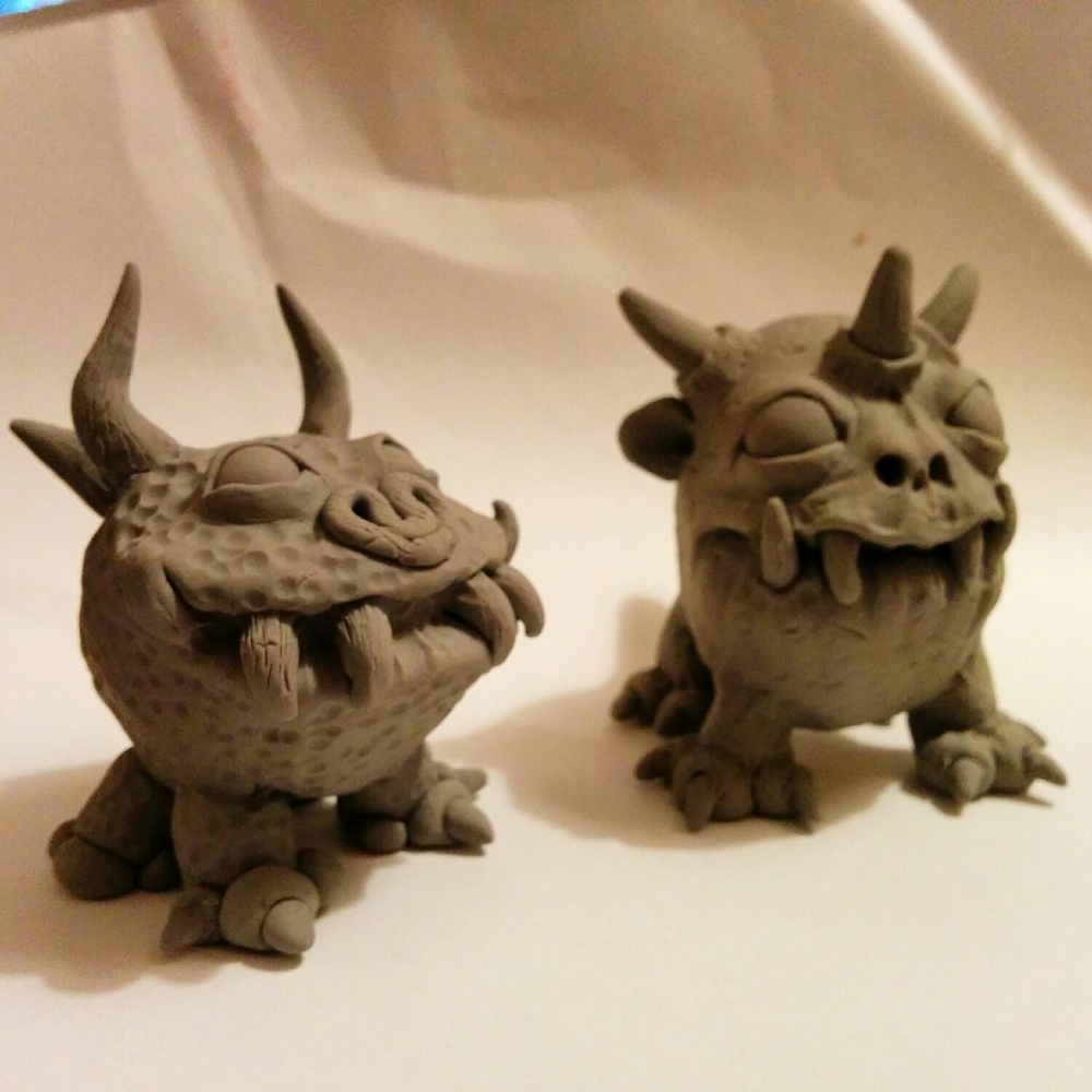 my sisters first super sculpey monster on the left, and my monsteron the left.