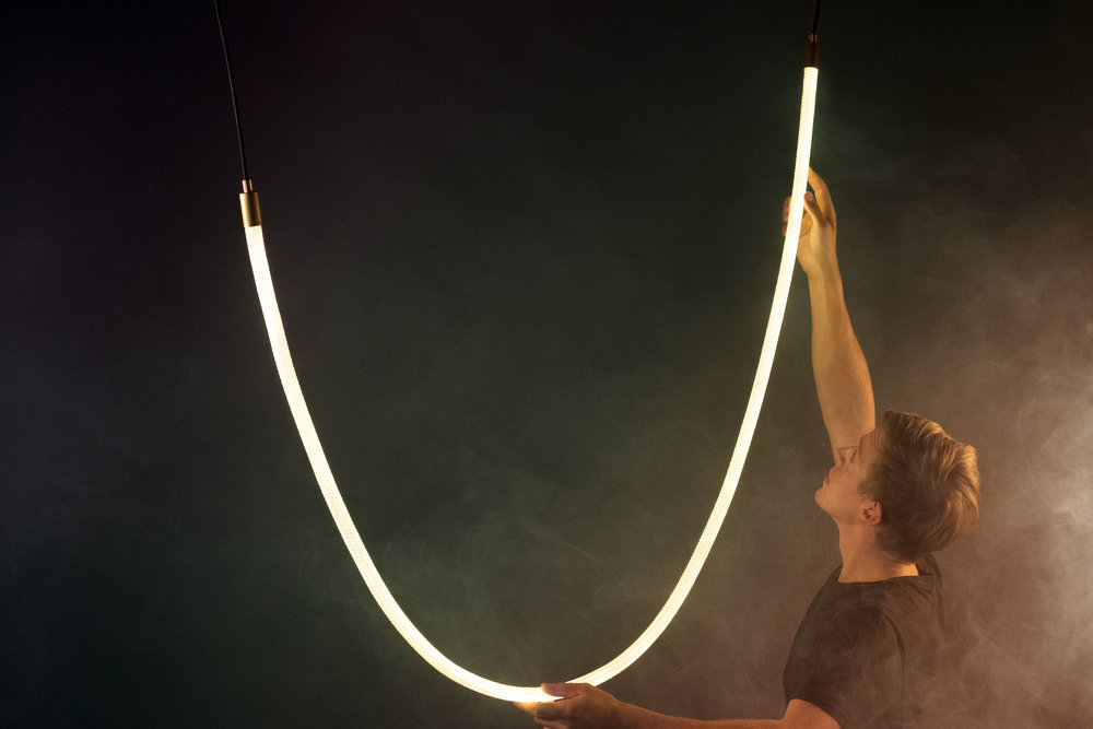 Our most popular fixture, the Tracer Loop is a complete reimagining of what lighting can accomplish. Flexible, dimmable, easy to install, and lit by energy-efficient LEDS, it's the perfect solution for unique interiors.  As pictured: 8 Foot Model (Brass Hardware, Pendant Cord Attachment)