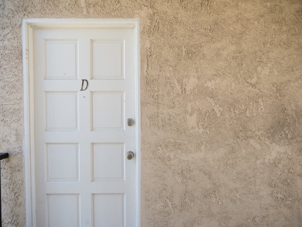 "White door with the Letter ""D"" on it. ISO 400, f/2.8, 1/1000th"
