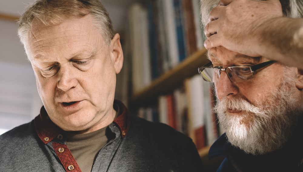 Tim Collier and Emyr Young browsing Tim's extensive Wildlife book collection. Image by Brian Carroll
