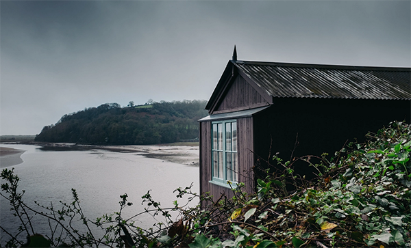 The Dylan Thomas writing shed overlooking the scenic estuary in Laugharne.