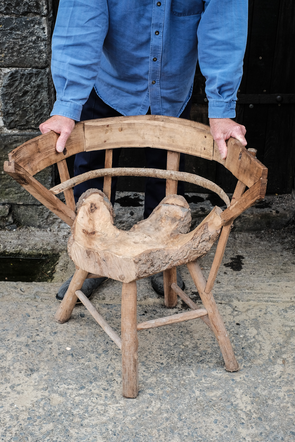 And felled tree becomes a handmade chair!