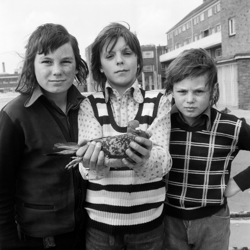 John Payne, aged 12, with friends and his pigeon Chequer.