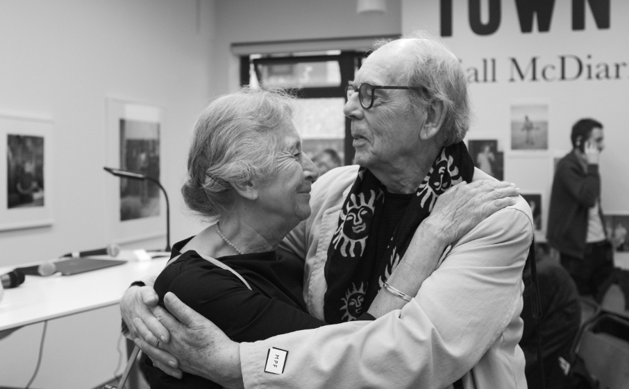 A lovely moment of mutual respect: photographers and old friends Markéta Luskačová and David Hurn catch up after many years. © Brian Carroll