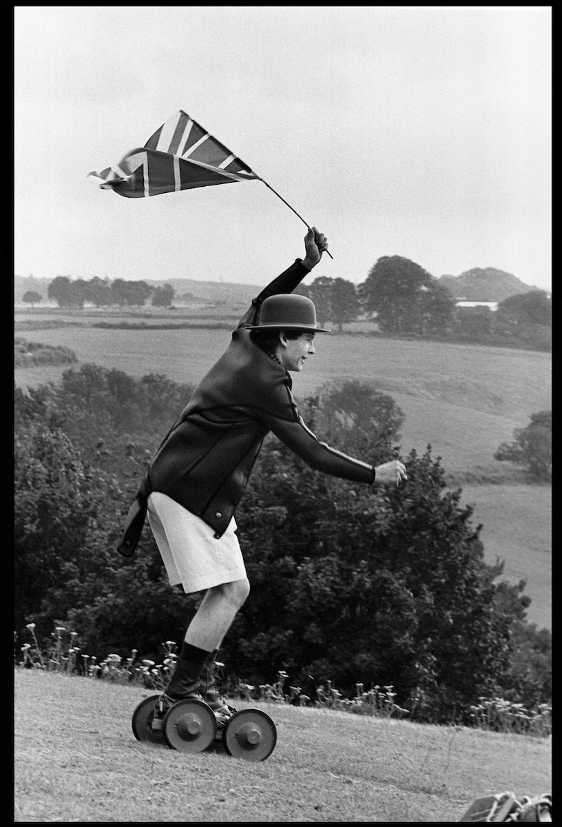 Crispin Balfour rolling along at the Dangerous Sports Club Tea party, 1981.