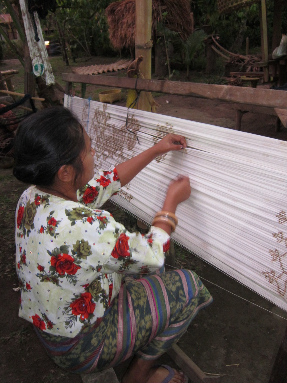 Ikat, tying small bundles of threads. Flores, Indonesia