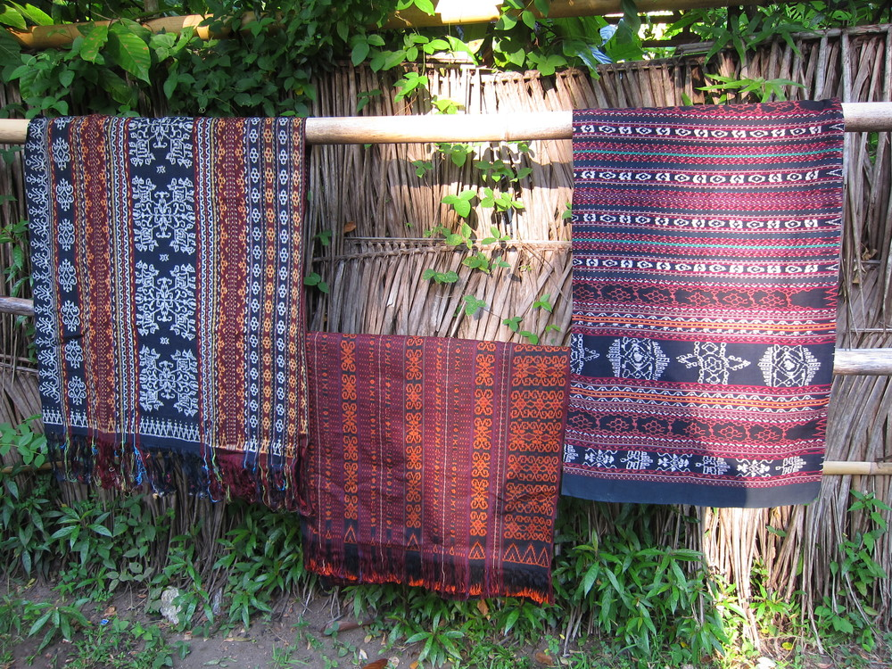 Ikat cloth in the middle (purple)