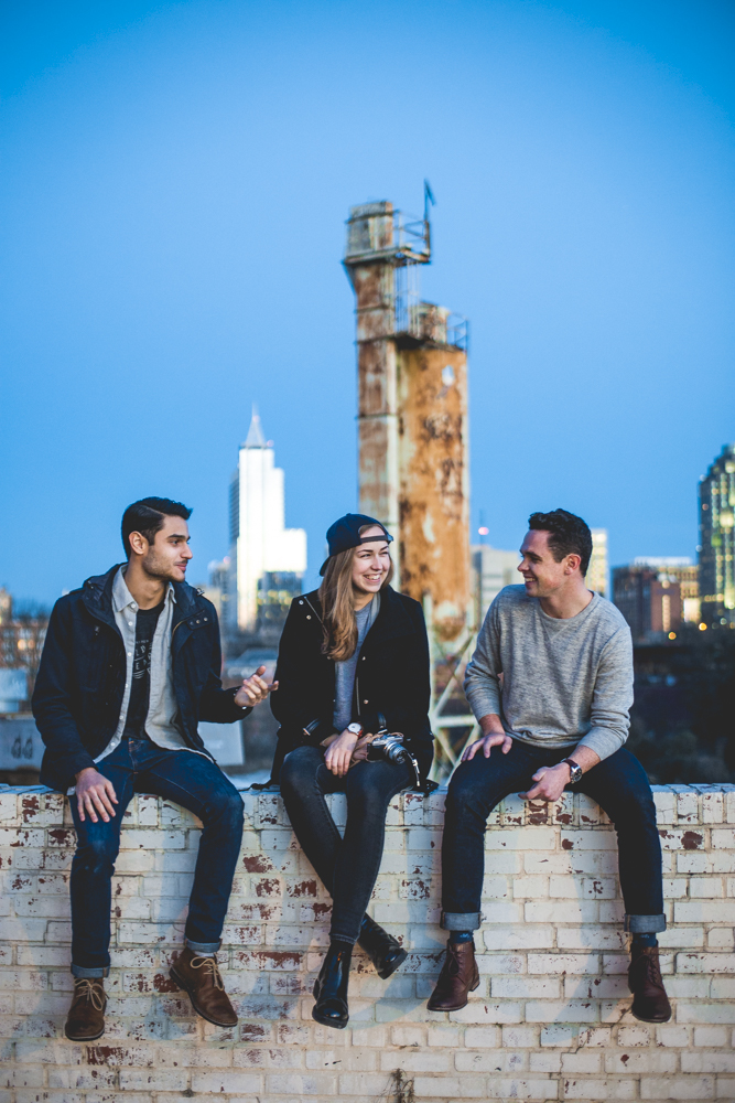 A fun filled photo shoot in front of the downtown Raleigh skyline for mens clothing company Pitch & Primer.