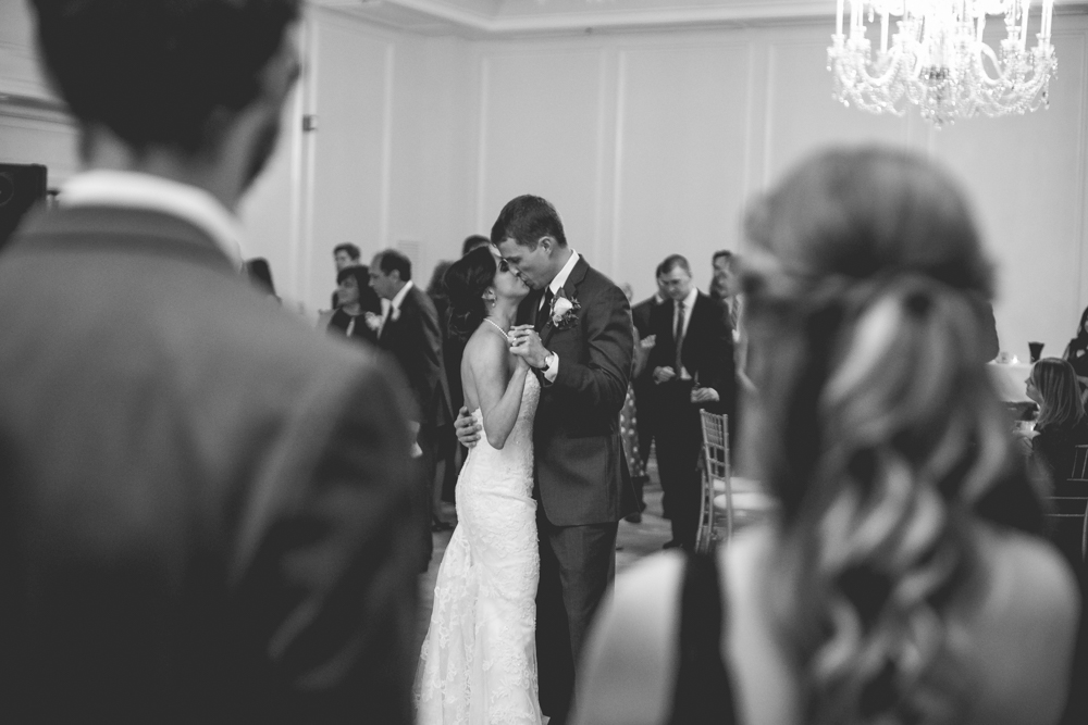 Bride and groom kiss during their first dance. Their wedding reception was inside the beautiful ball room at the Carolina Inn in Chapel Hill.