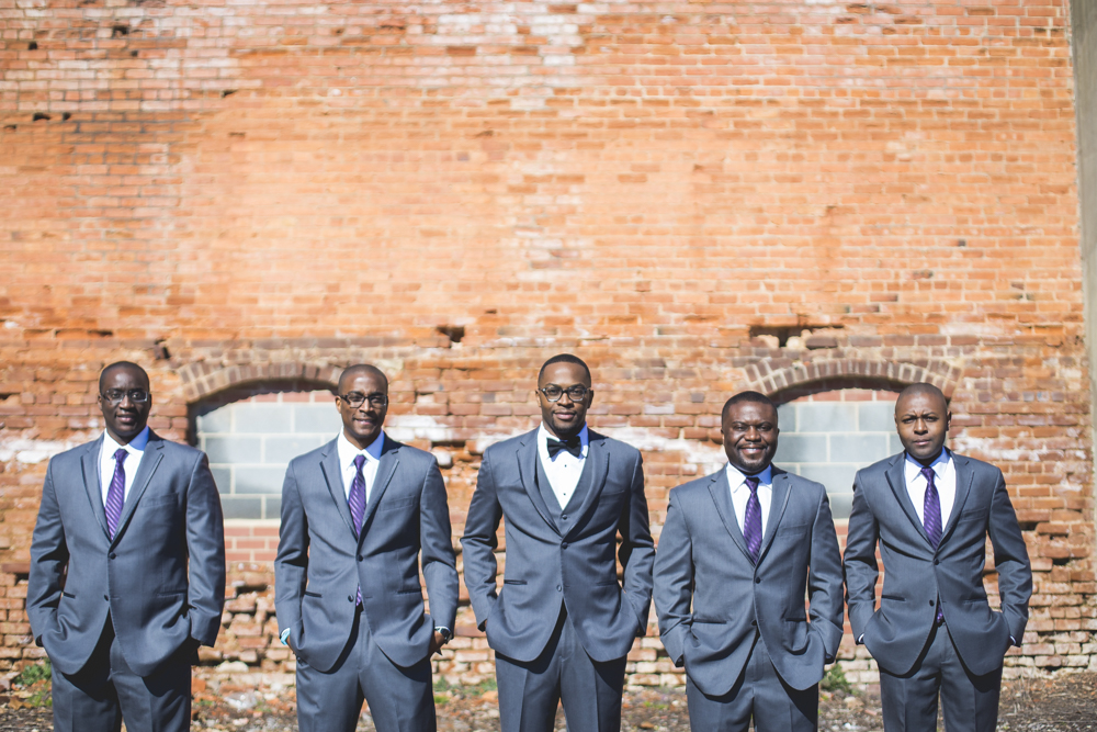 A groom and his groomsmen looking dapper in their wedding attire.
