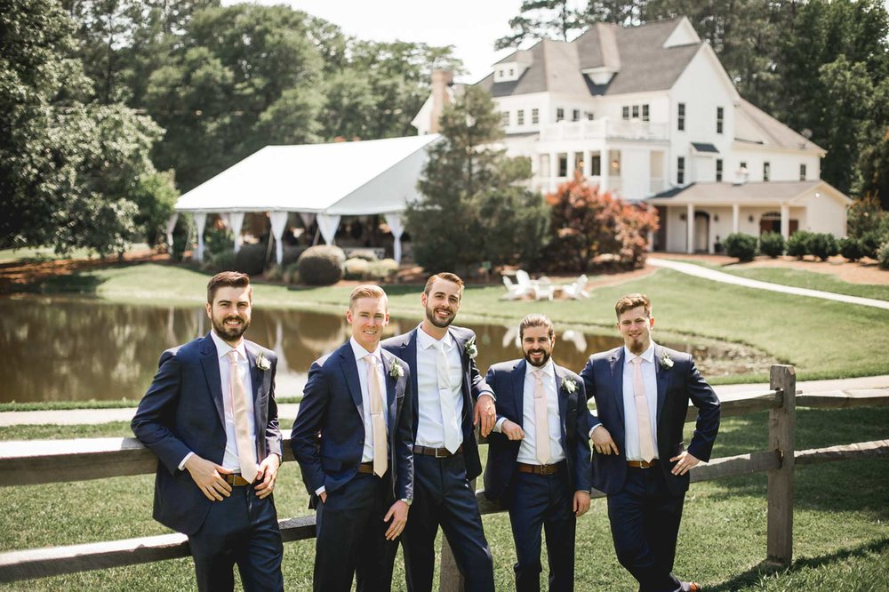 grooms-chilling-at-the-oaks-of-salem-wedding-venue.jpg