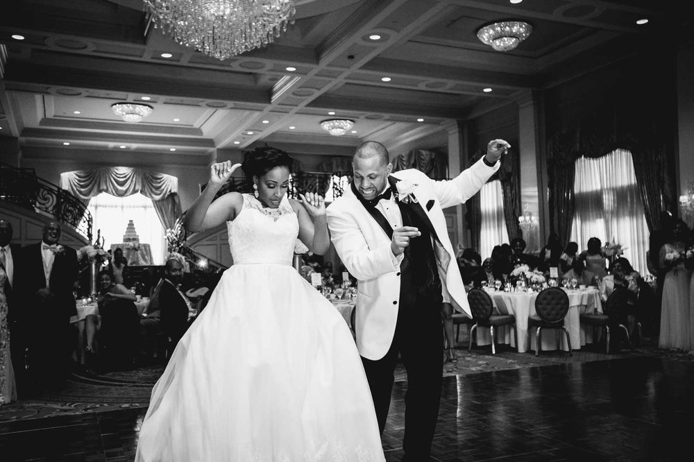 Bride and groom bust out some incredible dance moves during their wedding at the Prestonwood Country Club Ballroom in Cary, NC.