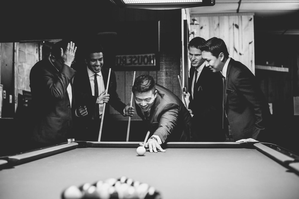 groomsmen-playing-game-of-billiards.jpg