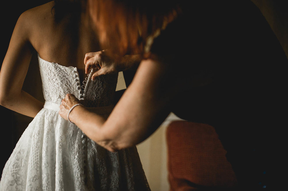 mom-lacing-up-wedding-dress.jpg