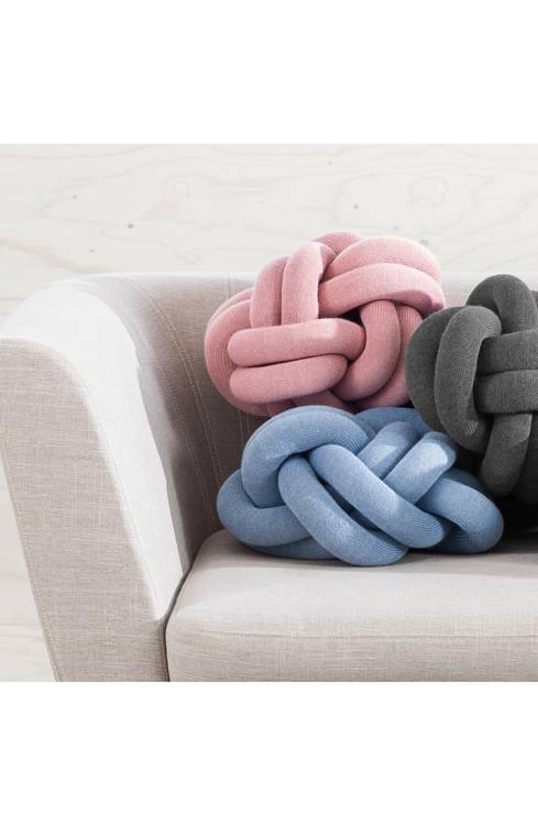 A soft knit-fabric tube is intricately looped and knotted to make a cozy, chunky cushion that's both chic and charming.